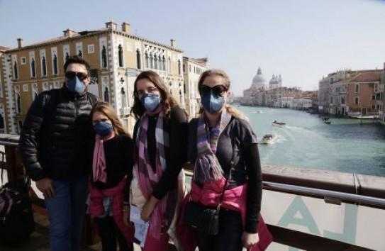 «Бокал вина — и все пройдет»: как реагируют на коронавирус в Италии